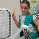 Girl Scout tests wind technology during Careers in Energy Week.